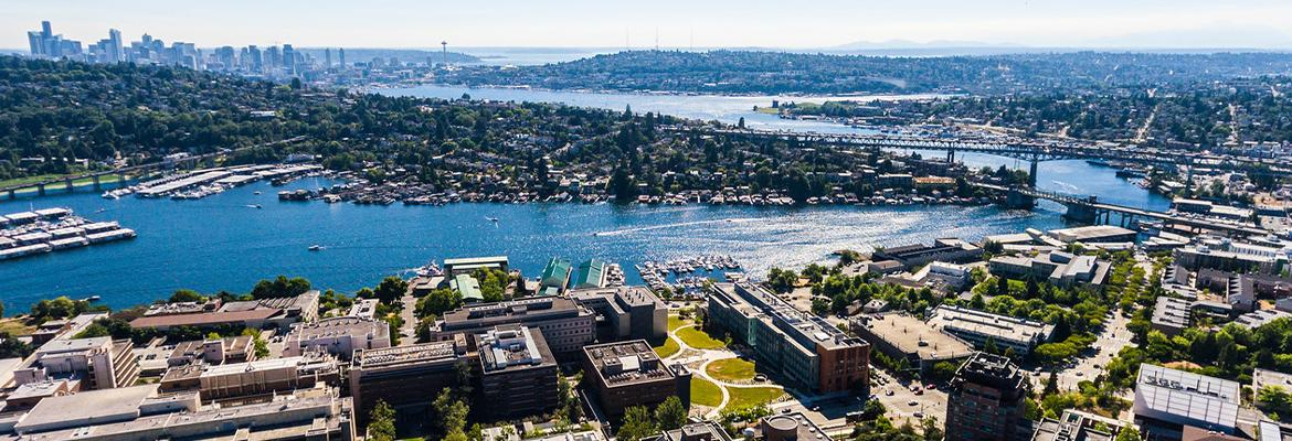Aerial photo of the south side of the UW campus with Seattle in the distance