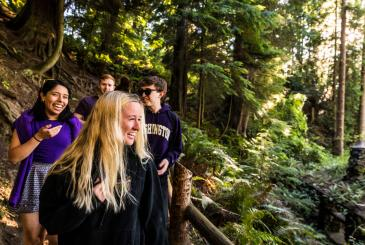 Four Students Walking down a forest path on Whidbey Island